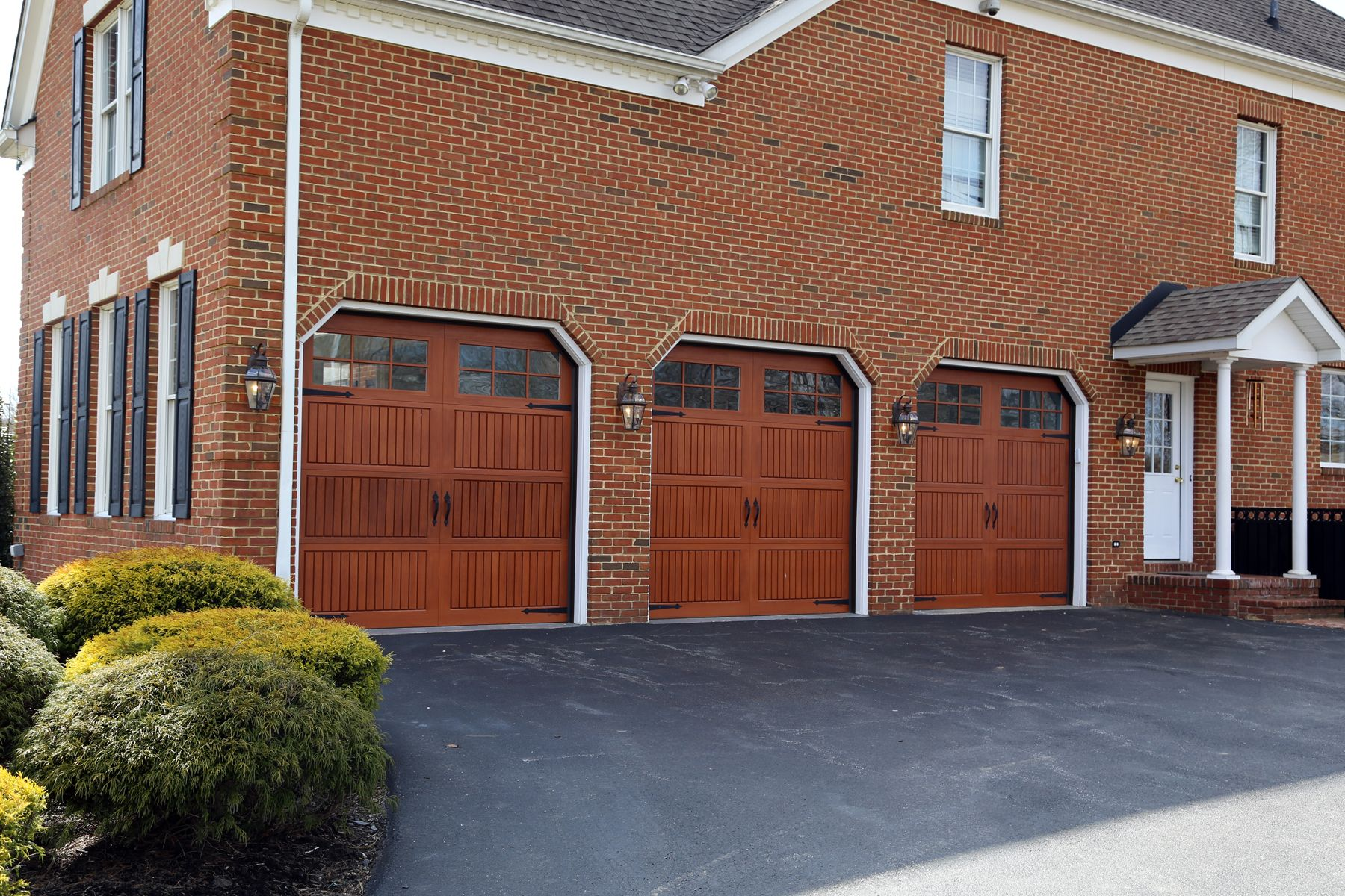 Beautiful fiberglass garage doors installed on a home in Bethesda MD. Impression Collection garage doors require much less maintenance than natural wood. & Impression Collection Model 983 Garage Doors in a Cherry Stain ...