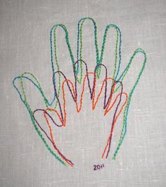 handprint family portrait embroidery.
