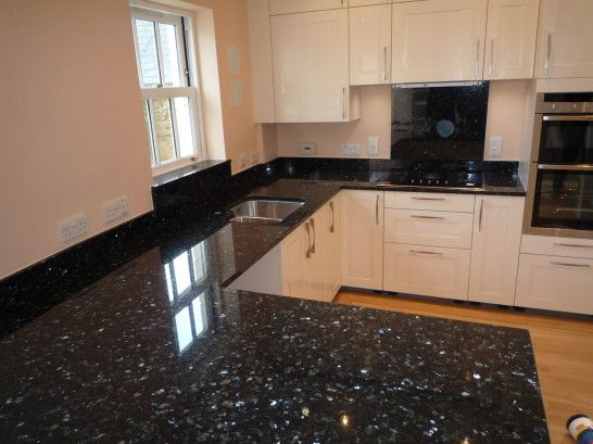 Interior elegant nuance of black pearl granite shown by - Black granite countertops with cream cabinets ...