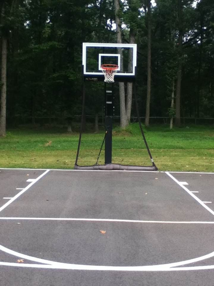 A backyard half court with striping is can be an inspiring ...