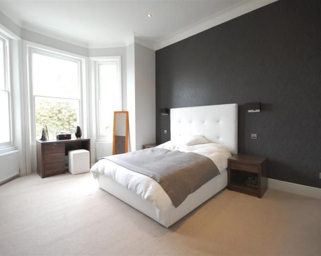 Photo of cool black white white leather bedroom with for Grey feature wallpaper bedroom