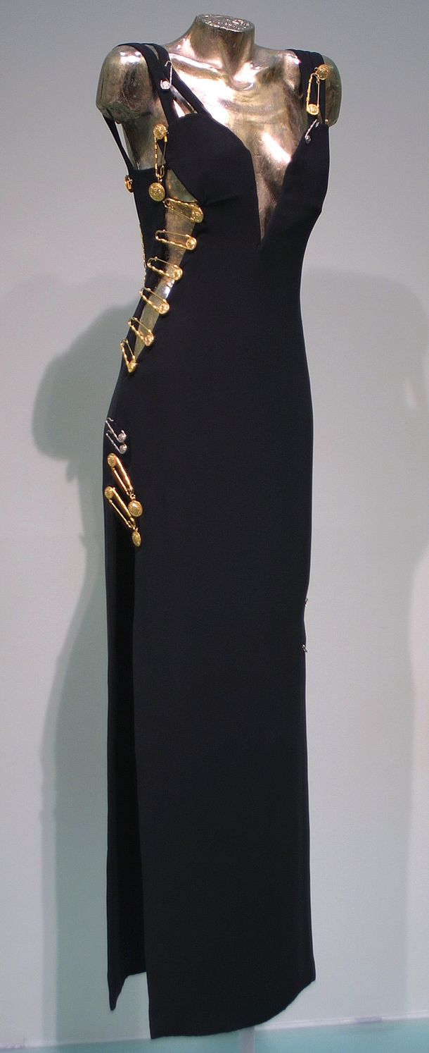 164b6fc581d1 Evening gown worn by Elizabeth Hurley, Spring-Summer 1994, Versace, black  viscose and acetate with kilt pin embellishments