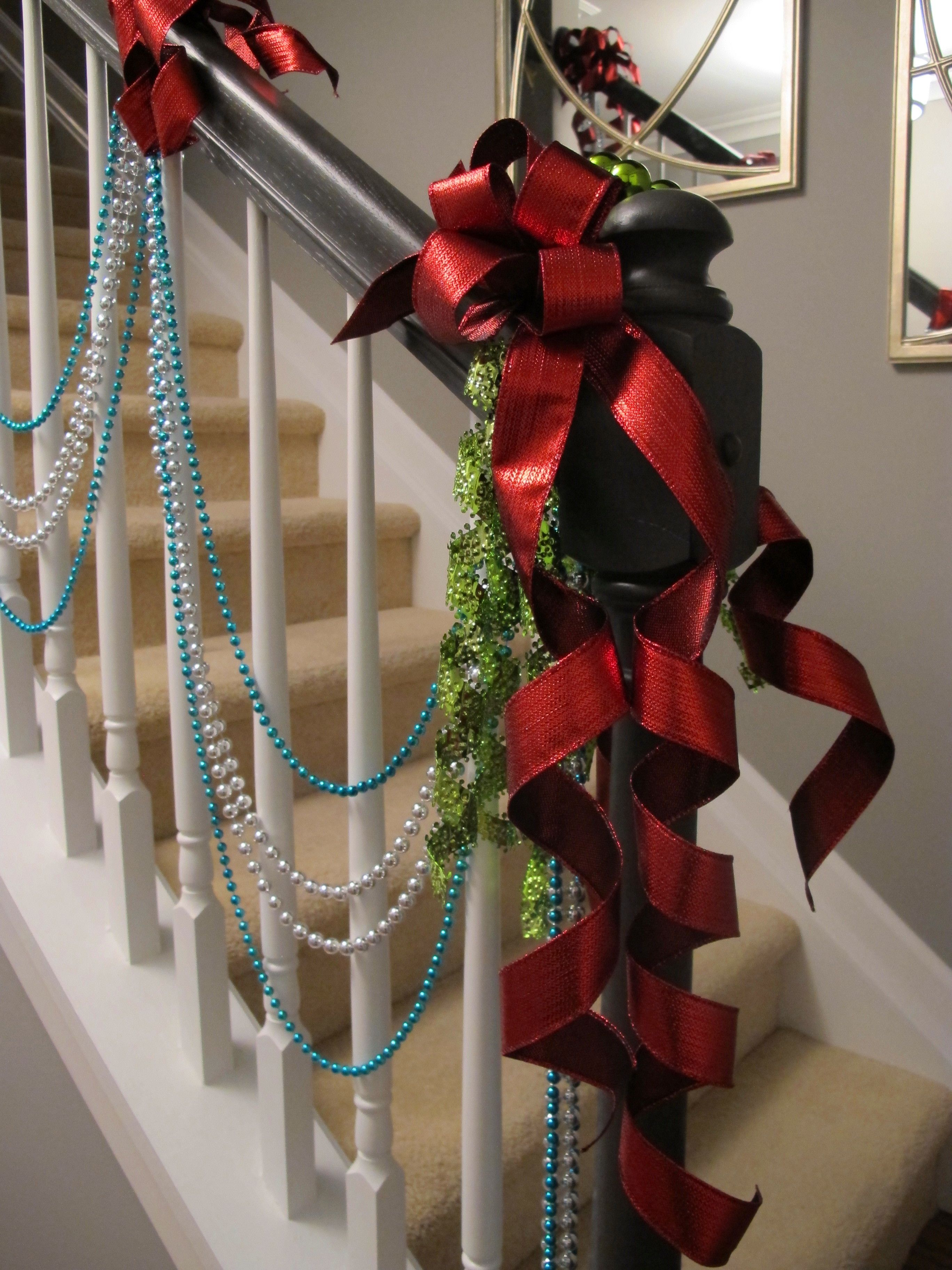 Decorating banisters for christmas with ribbon - Ribbon Clusters With Draped Beads On A Small Banister Add Christmas Cheer