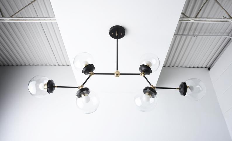 Modern Globe Chandelier Black Brass Linear Chandelier Etsy In 2020 Linear Chandelier Globe Chandelier Black Chandelier