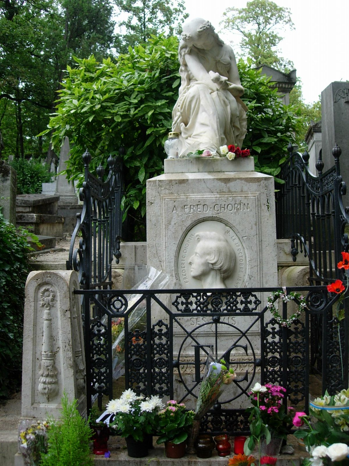 The grave of Frederick Chopin at Pere Lachaise Cemetery in