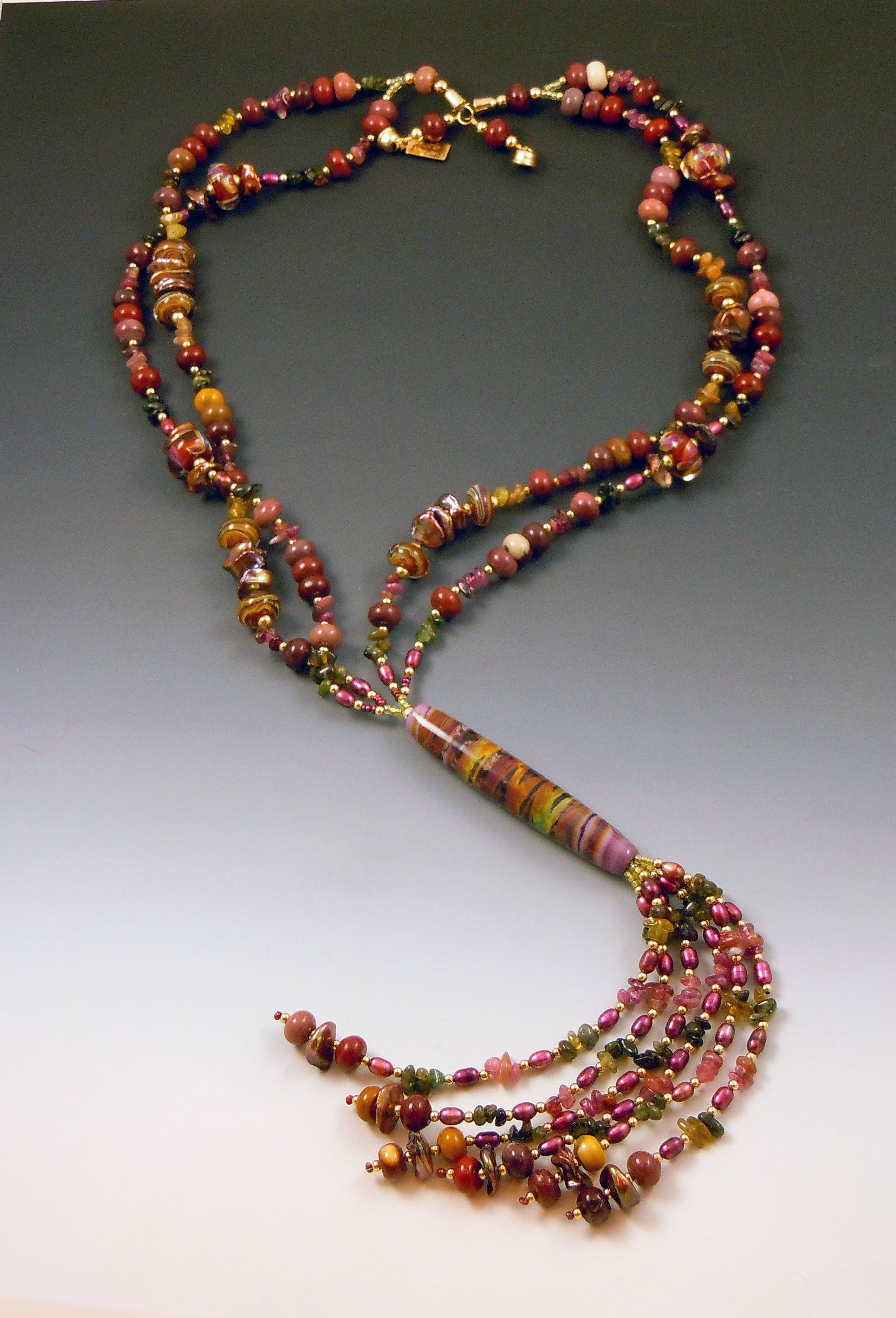 Tourmaline Sunset by Barb Cohan-Saavedra.  Tourmalines, jasper, freshwater pearls, GF beads and findings, and lampworked glass focal bead and accents.