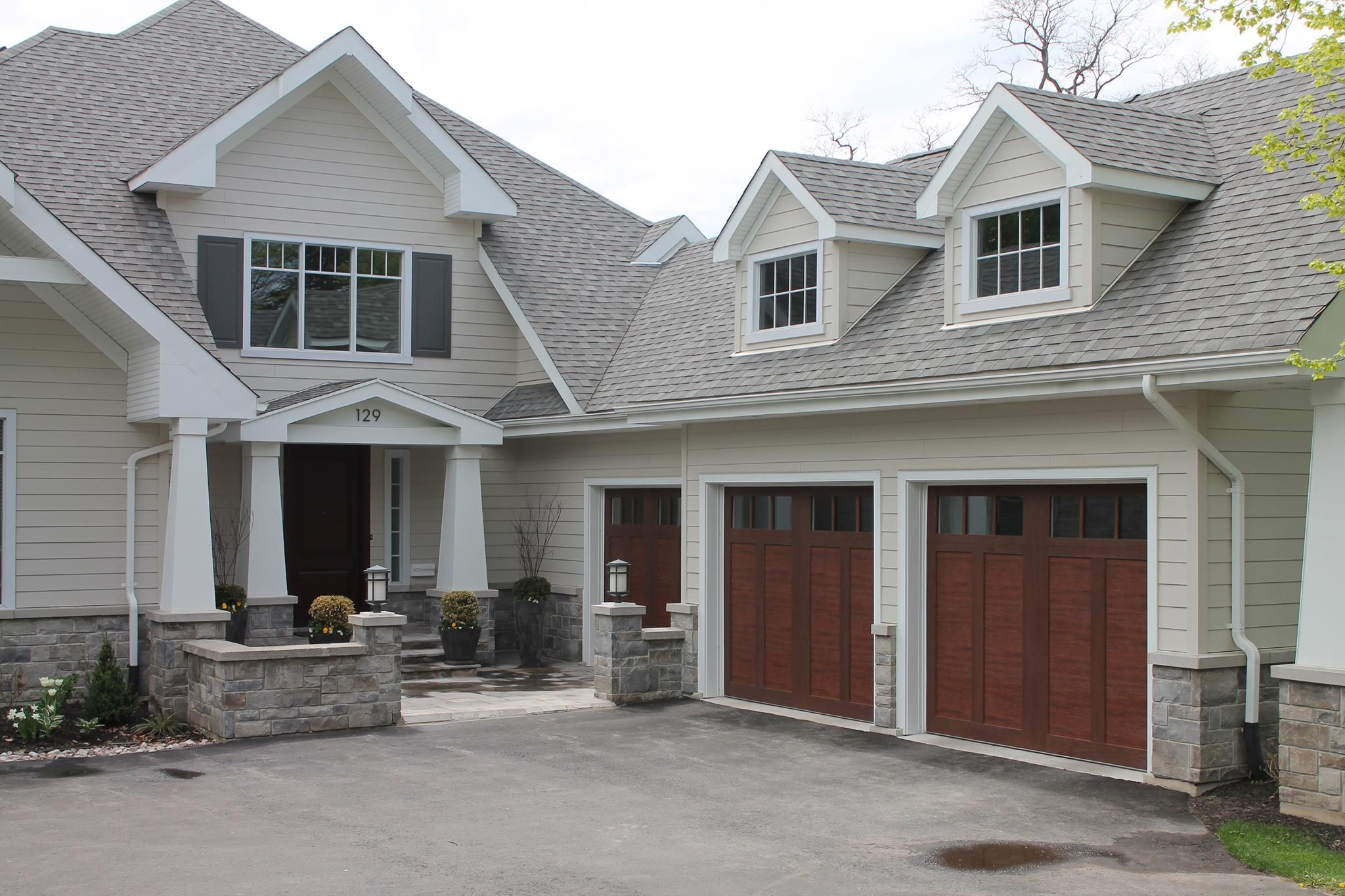 These garage doors may look like wood but they are for Wood look garage doors