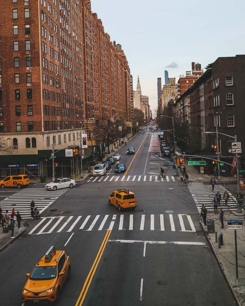 View of a street with yellow taxis from New York's High line   Essential guide for your first time in New York City - what to see and do #nyc #newyork