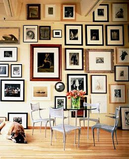 photo wall ideas.... From the floor all the way up to the ceiling!