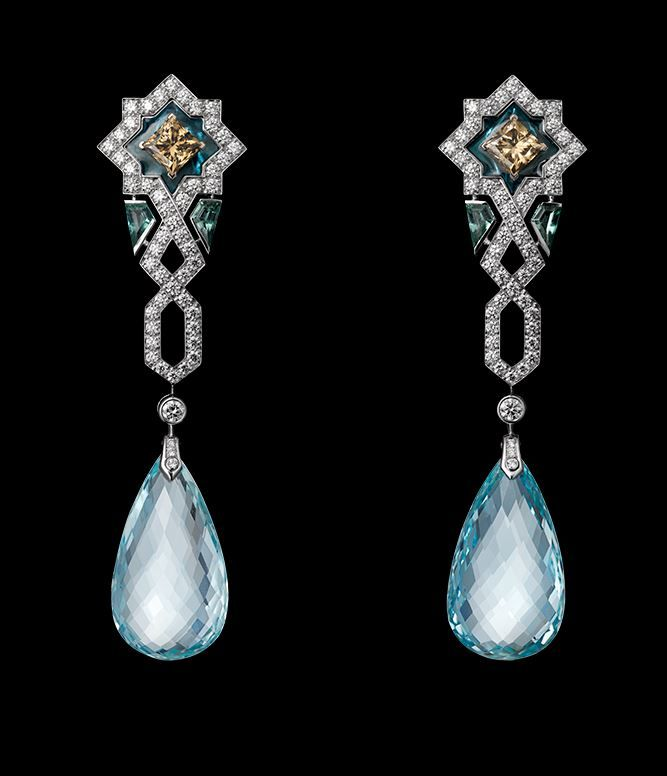 Oriental Influences – High Jewelry Earrings White gold, two briolette-cut aquamarines totaling 32.87 carats, brown diamonds, plique à jour enamel, brilliants.