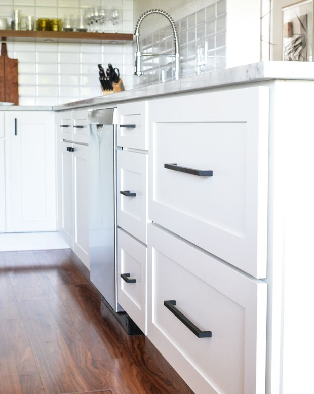 Image result for black bar pulls on white cabinets