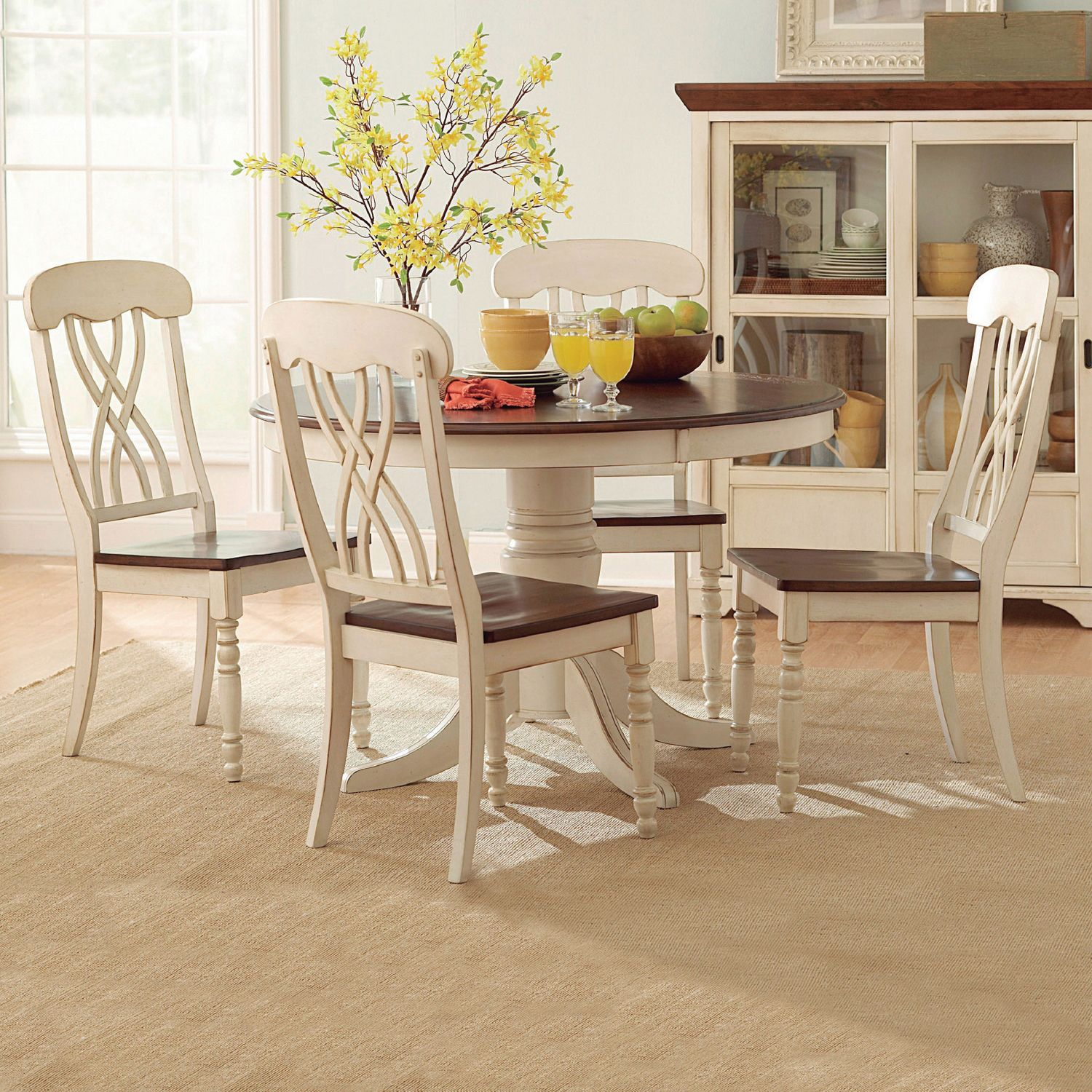 The design of this piece dining set from mackenzie captures the