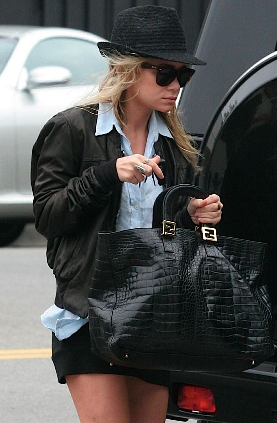 Ashley Olsen In A Vintage Alligator Fendi Bag Later Re Released By The House Due To Demand And May Have Served As Inspiration For Row S Day Luxe Tote