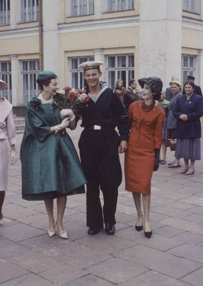 This photograph was taken in 1959, in Moscow, when the Soviet Union unofficially allowed designers to stage fashion shows and stopped persecuting people for wearing trendy clothes. Dior held a fashion show, which was shown to the Soviet elite and higher up members of the Communist party. However, to show the clothes to the people of Moscow, Dior took to the streets (which is how this picture came about).