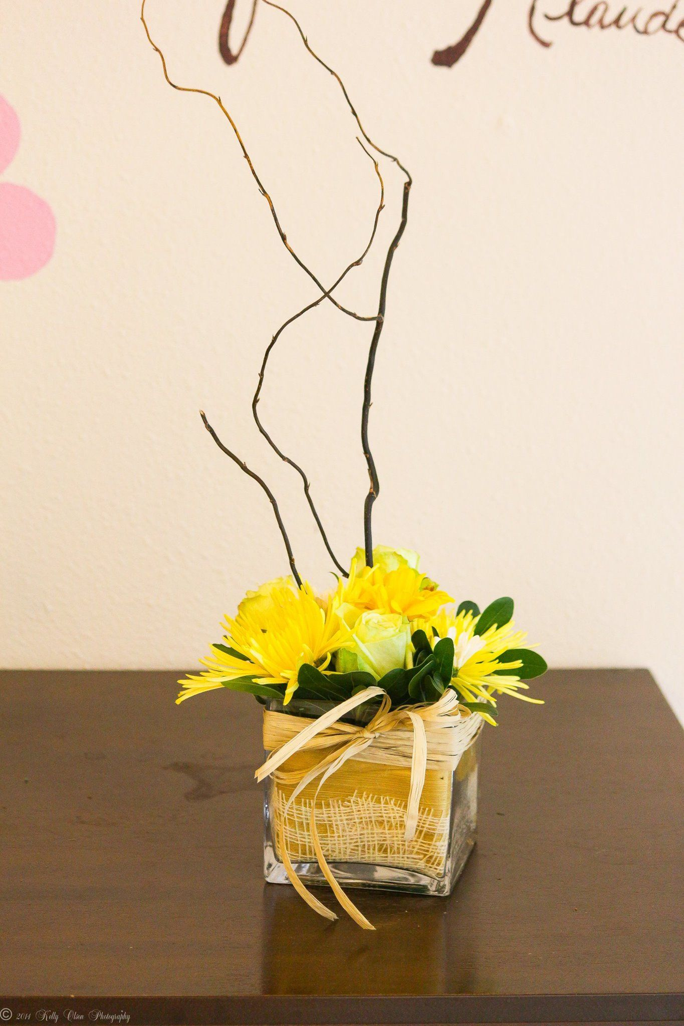 Rustic Centerpiece. Gold wrapped base with raffia, yellow flower and ...