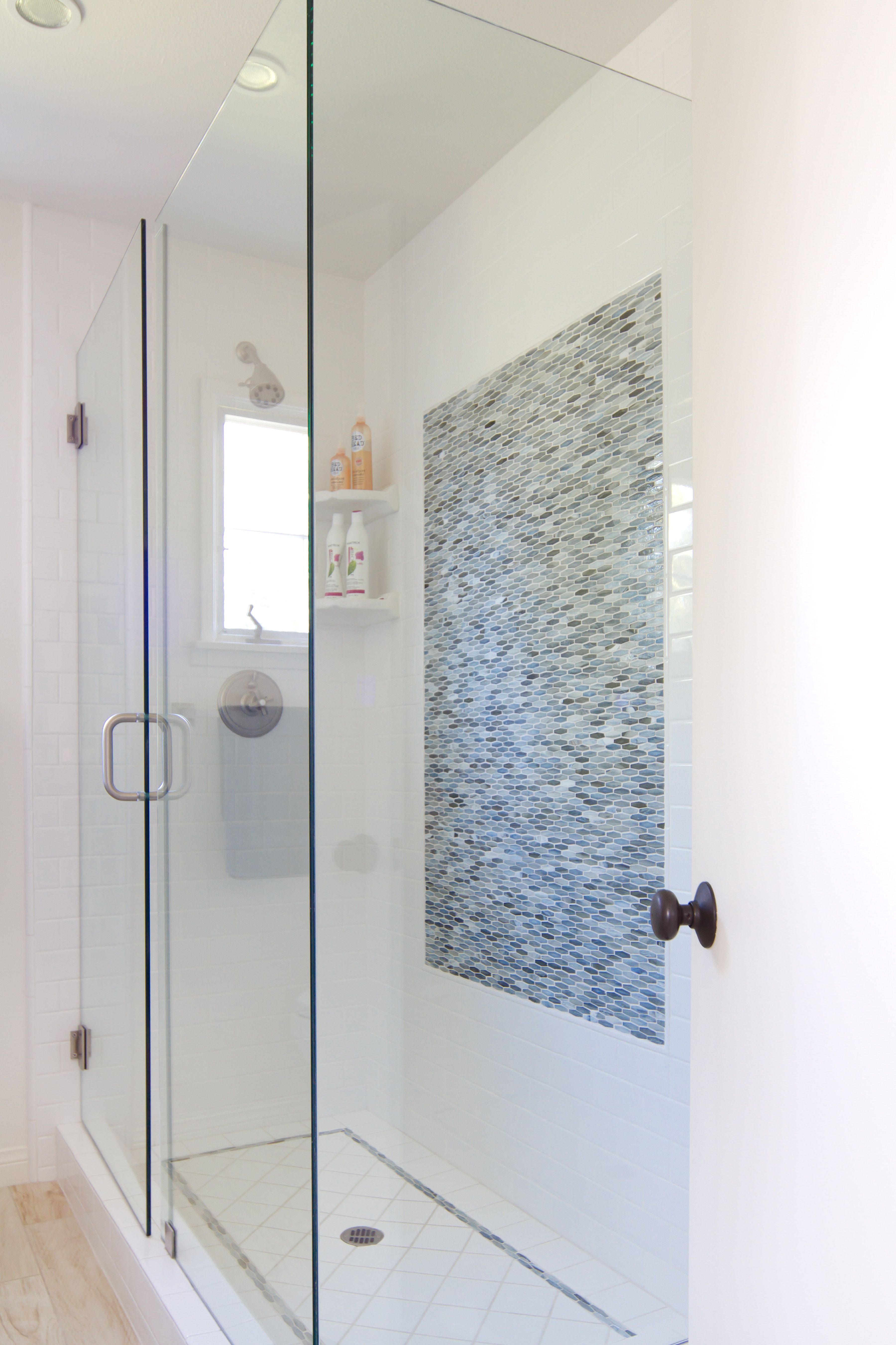 Glass mosaic tile inset by Stone & Pewter Accents. Design by ...