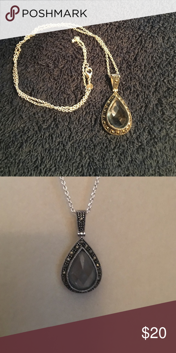 """Blue topaz pendant with 18"""" Sterling silver chain Pendant is 1 1/2 inches long x 3/4 inches wide. Chain is sterling silver 18"""" long. Jewelry Necklaces"""