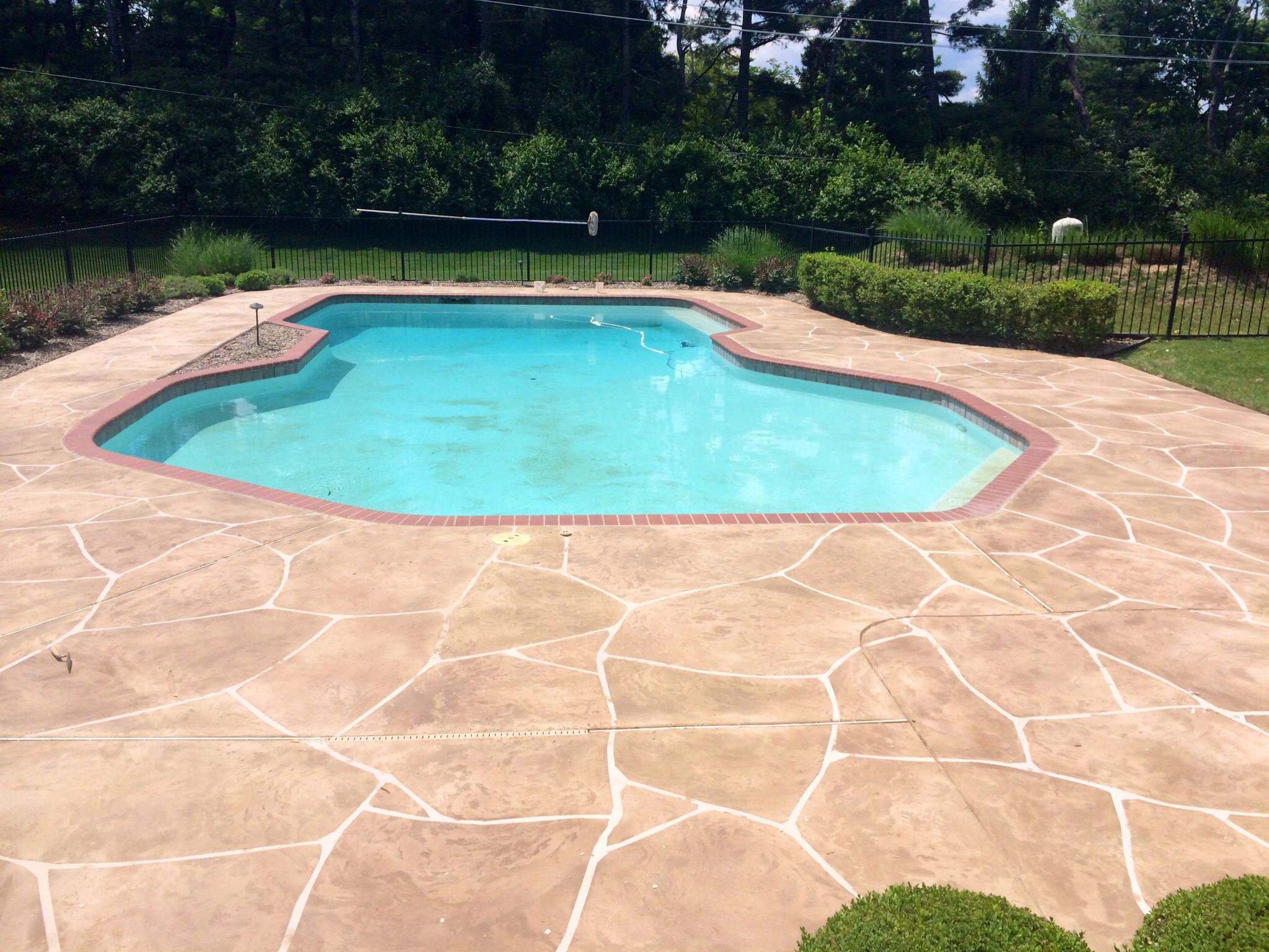 This Pool Deck Was Recently Transformed With Our Concrete Resurfacing From Plain Concrete To This Beautiful Random Concrete Pool Painted Pool Deck Pool Decks