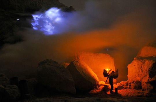 in the heart of ijen volcano in east java, indonesia