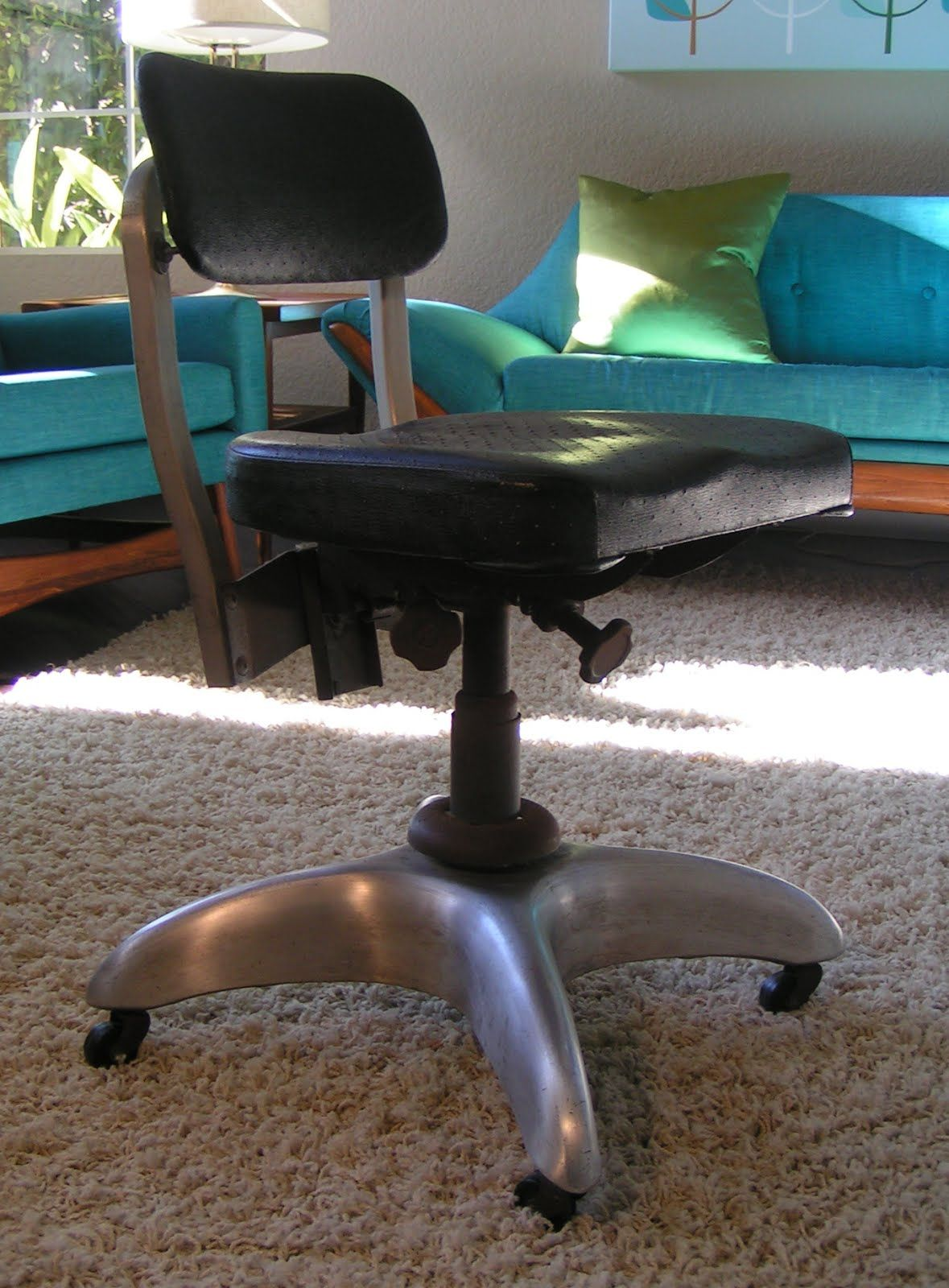 Uncomfortable, heavy and squeaky hand-me-down office chair.  Cool
