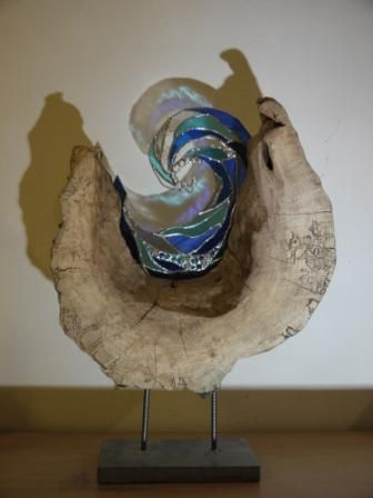 Log sculpture with stained glass wave