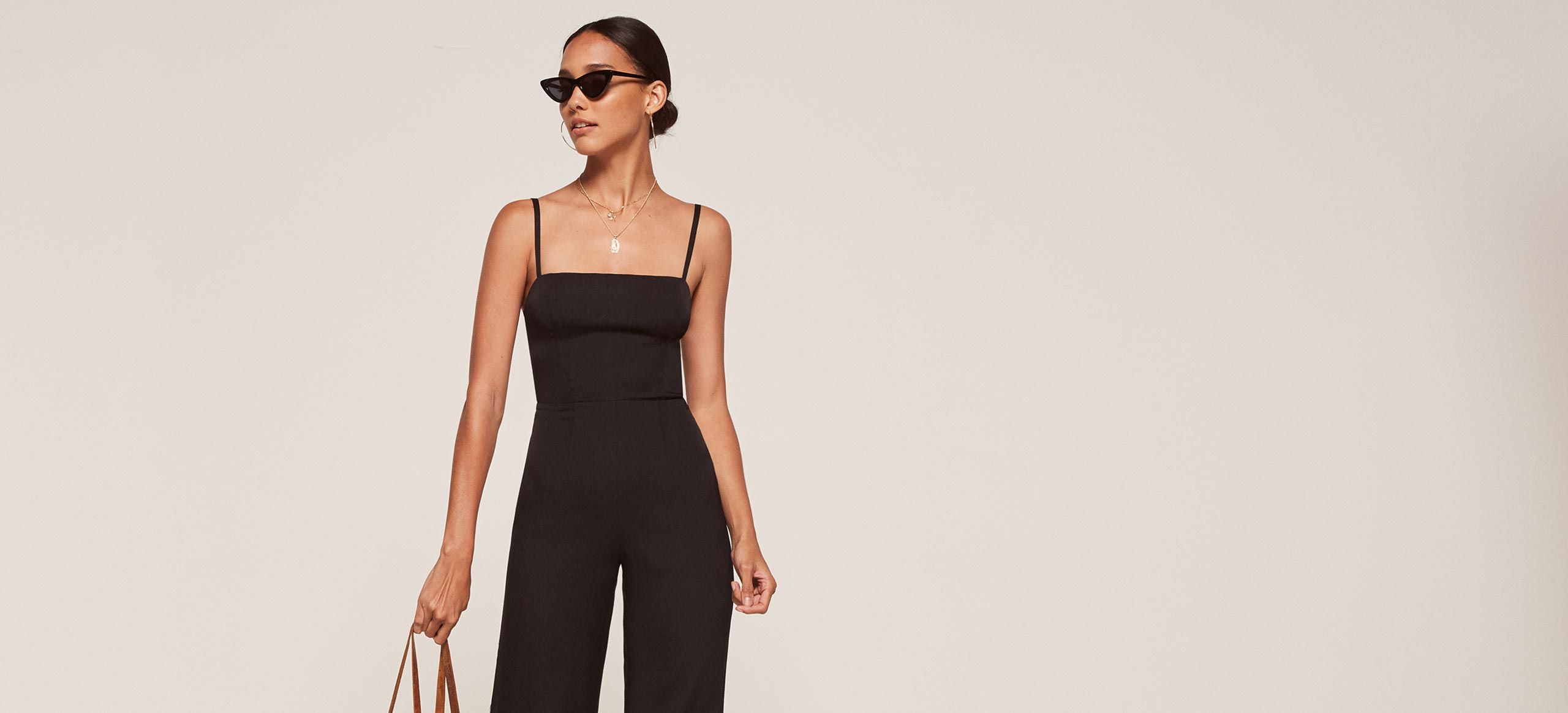 7990944b05 This is a straight neck jumpsuit with a tight fitting bodice and a wide leg.  This style comes in petite sizing.