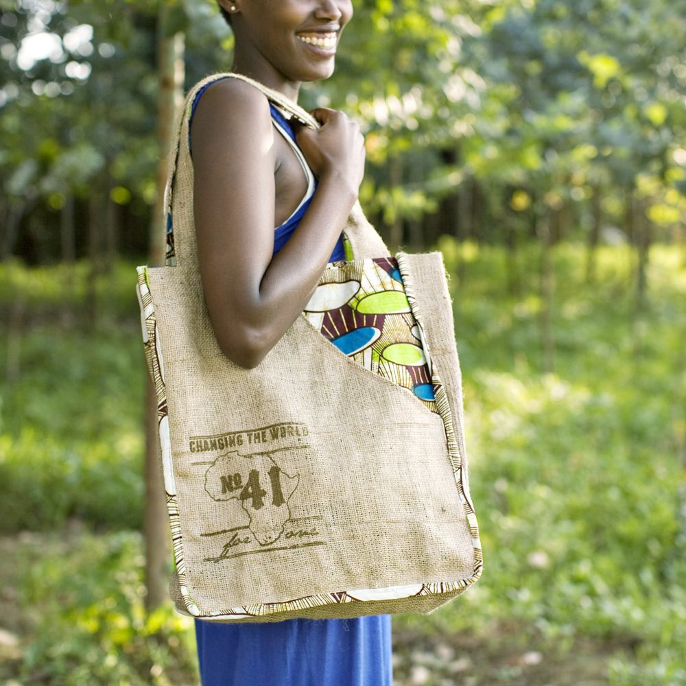 Your No.41 Signature Bag is handmade with love by young women in Gisenyi, Rwanda. Your purchase not only provides a stable job and sustainable income, you are also providing lunch for local secondary school students. FOR ONE child, FOR ONE meal, FOR ONE year. -100% natural burlap and African ikt...