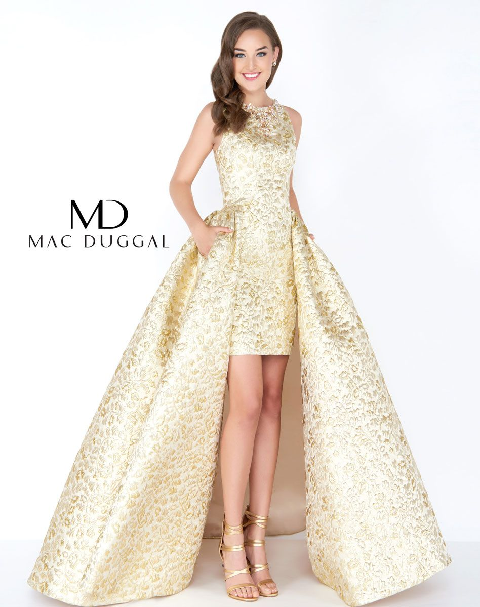 Ravishing metallic gold embossed brocade prom dress featuring a beaded  Jewel neckline with short column skirt accented with a overksirt. fd9a6d0efbc3