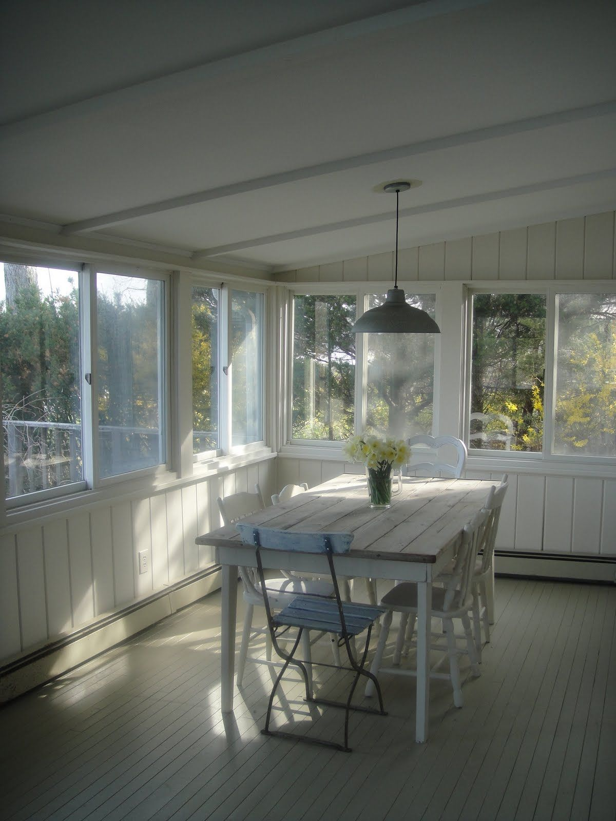 my most favorite kind of enclosed porch...windows spanning the whole length and width. i would buy a sub par house if it had a porch like this.