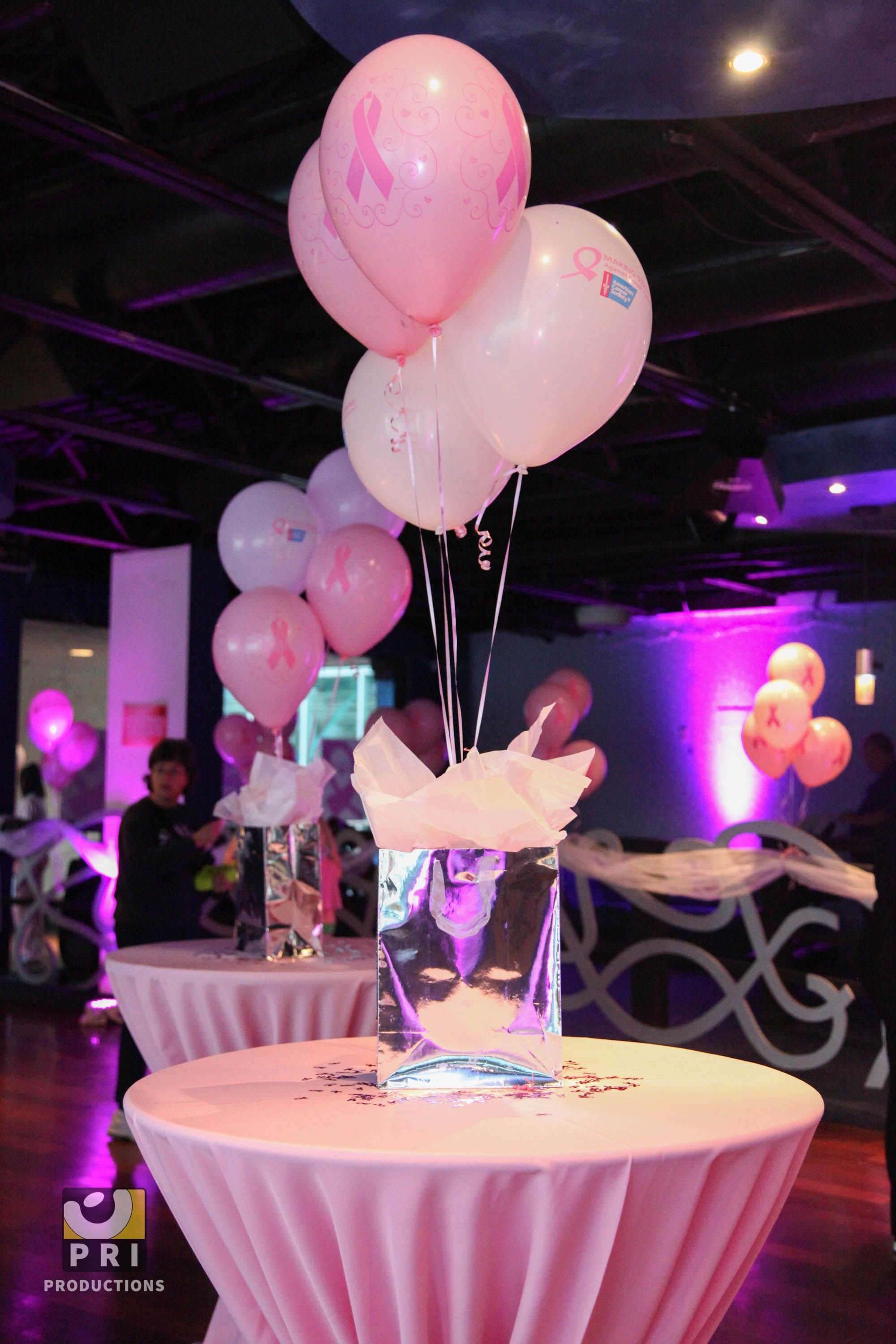 pink balloon and gift bag centerpiece with matching table