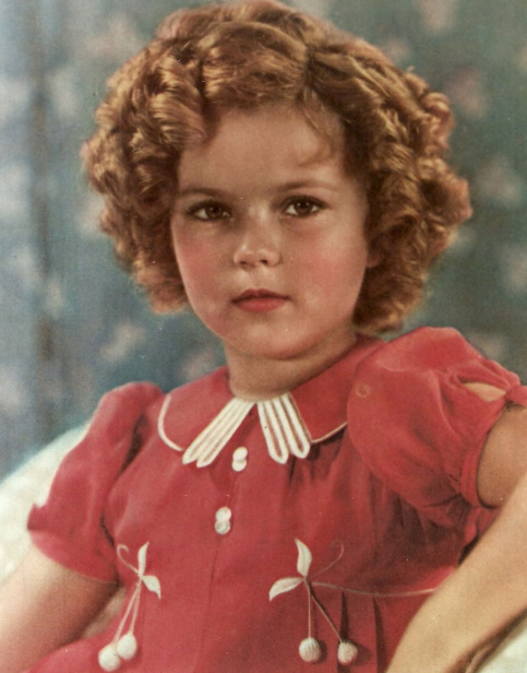 Shirley Temple, looking like a doll herself. Cute, precocious, dimpled  singer and dancer from the 1930's. | Shirley temple, Shirley temple black,  Shirly temple