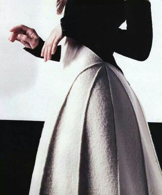 Chanel created a beautiful shaped skirt with an elongated line that makes a body to appear skinny and sexy, long lines create a visual effect of length and femininity
