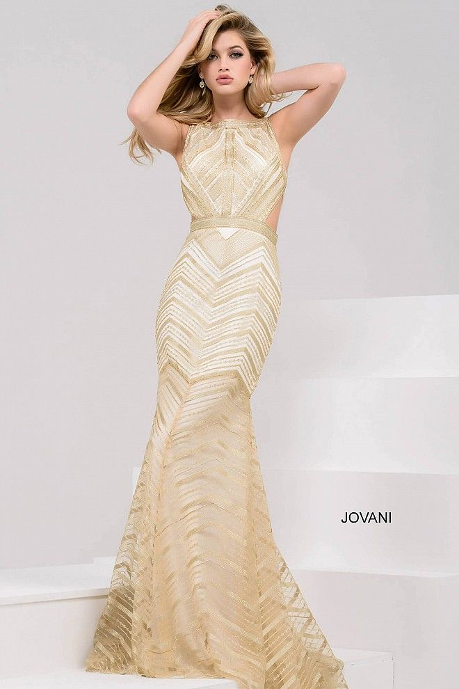 c3a98d40bd18 Stunning floor length form fitting gold embellished evening gown with ivory  underlay features sleeveless bodice with high neckline and side cut outs.
