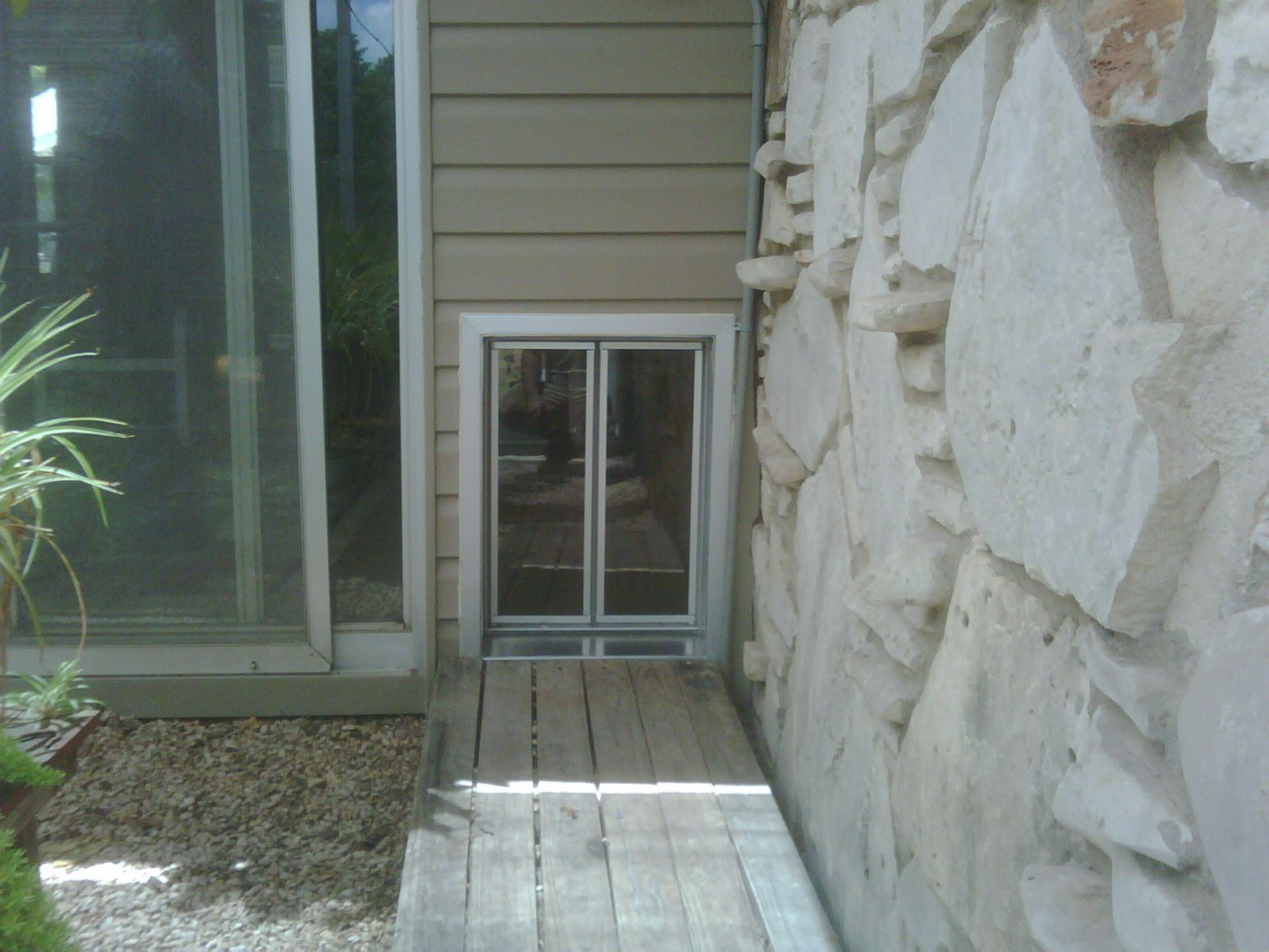 PlexiDor XL dog door installation, courtesy of Alamo Pet