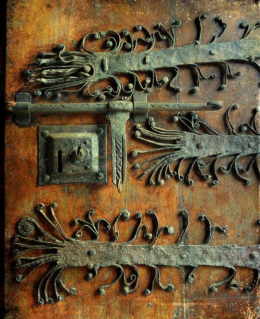 rusty door + beautiful hardware.