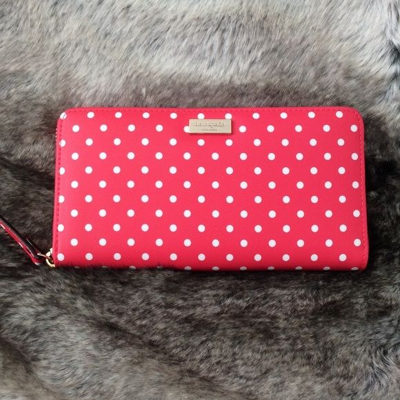 """HP NWT Kate Spade Polka Dot Zip Around Wallet Kate Spade Grant Street Neda Grainy Vinyl Wallet In Desert Rose with polka dots. MATERIAL classic polka dot printed saffiano textured grainy vinyl custom woven kate spade new york lining 14-karat light gold plated hardware FEATURES zip around continental wallet 12 credit card slots, 2 billfolds, zipper change pocket and exterior slide pocket DETAILS 3.9""""h x 7.6""""w x .8""""d kate spade Bags Wallets"""