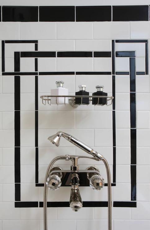 Art deco shower features black and white tiles lined with a metal ...
