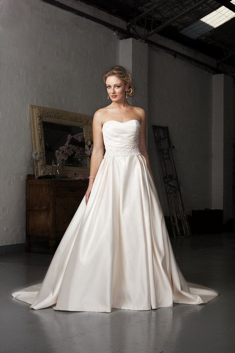 7973 - Romantic satin ballgown with subtle sweetheart neckline, pleated skirt, and scalloped beaded lace waistband.