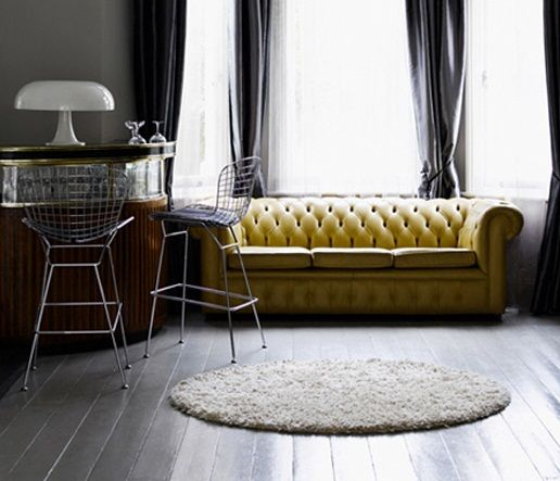 Mustard leather couch, grey floor