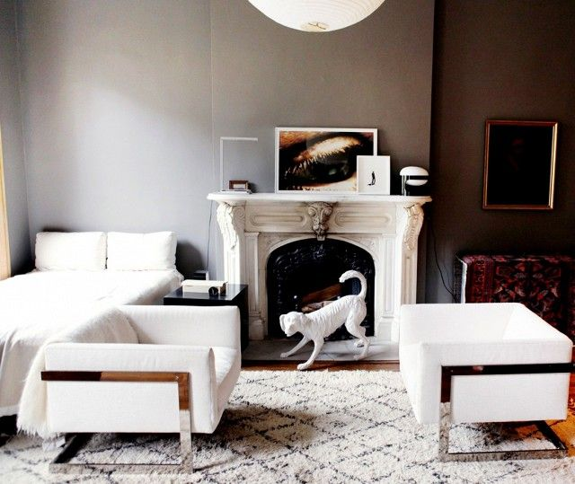 In this wholly sophisticated small space, a dramatic wall color and equally compelling collection of vintage furniture are elegant and luxurious, far more so than the apartment's square...