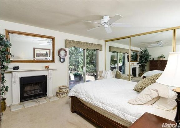 What a great use of neutral colors to highlight special features like a fireplace in the master suite!  This room looks bigger but still cozy and comfy.  This is a 2 bed 2 bath home with a vineyard and apple orchard in Somerset California loacted at 6221 GRANITE SPRINGS Rd!