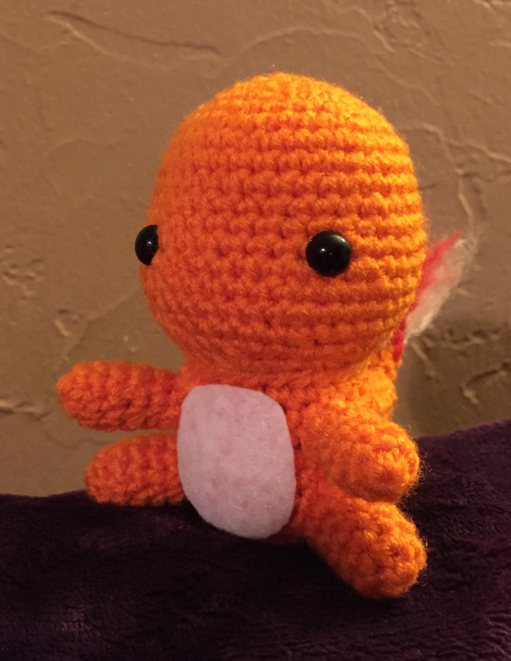 Charmander pattern can be found here: http://53stitches.tumblr.com/post/96536099762/charmander-amigurumi-pattern