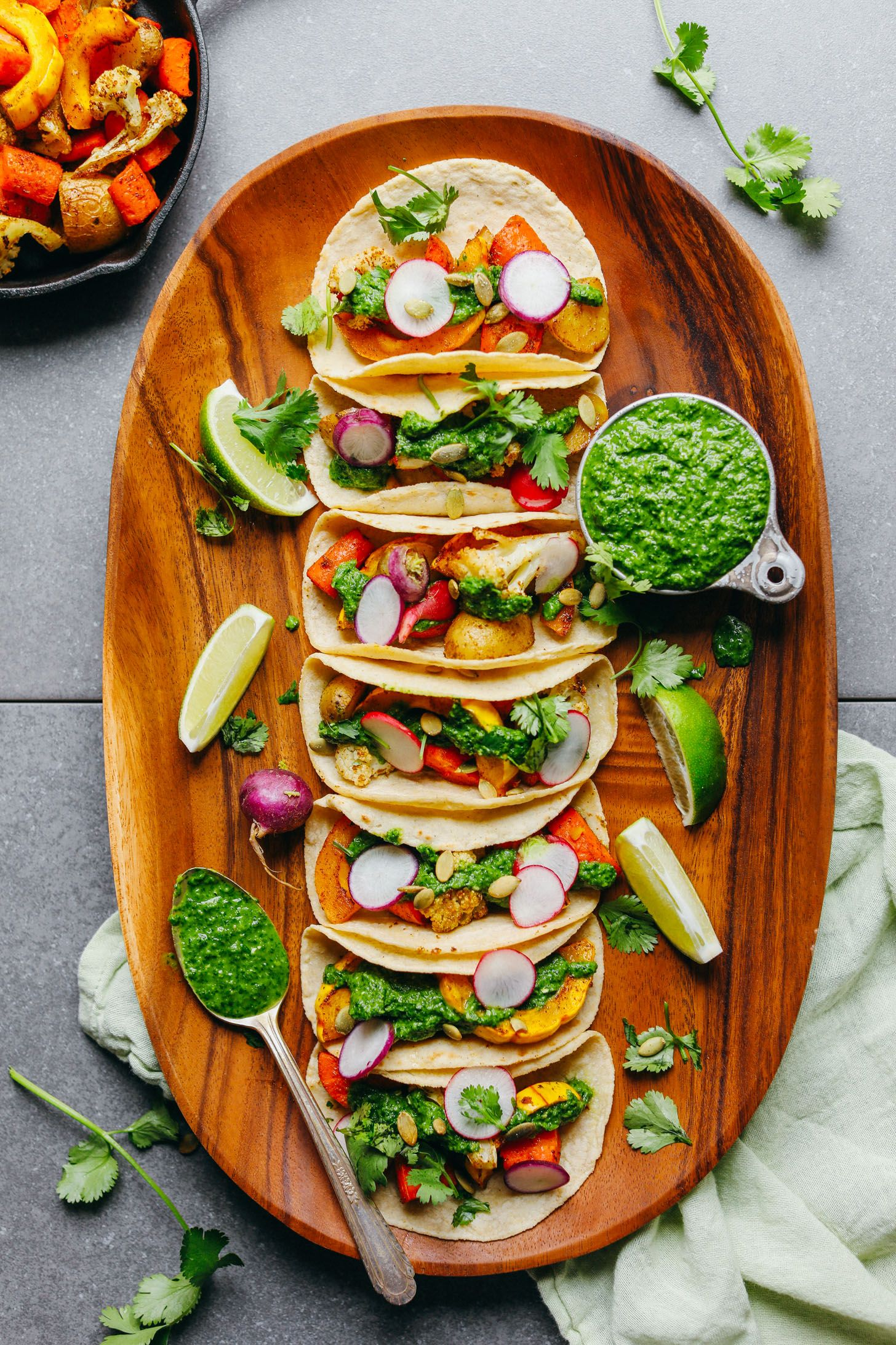 An easy, 30-minute plant-based meal: roasted vegetable tacos seasoned with spices, wrapped inside warm tortillas, and topped with vibrant chimichurri! Seasonally versatile, big flavor, so healthy!