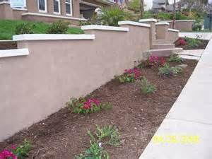 Stucco Retaining Wall With Stucco Cantilever Cap Landscaping Retaining Walls Concrete Retaining Walls Home Landscaping