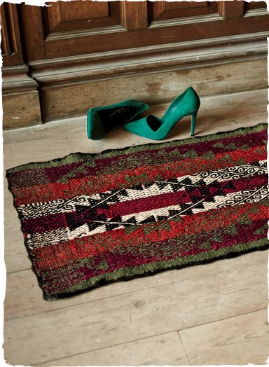Inspired by a traditional Altiplano region belt design, this stunning wool rug is handwoven in authentic vegetal-dye hues of madder, burgundy, cream and olive. Beautiful on the floor or thrown over the back of a sofa.