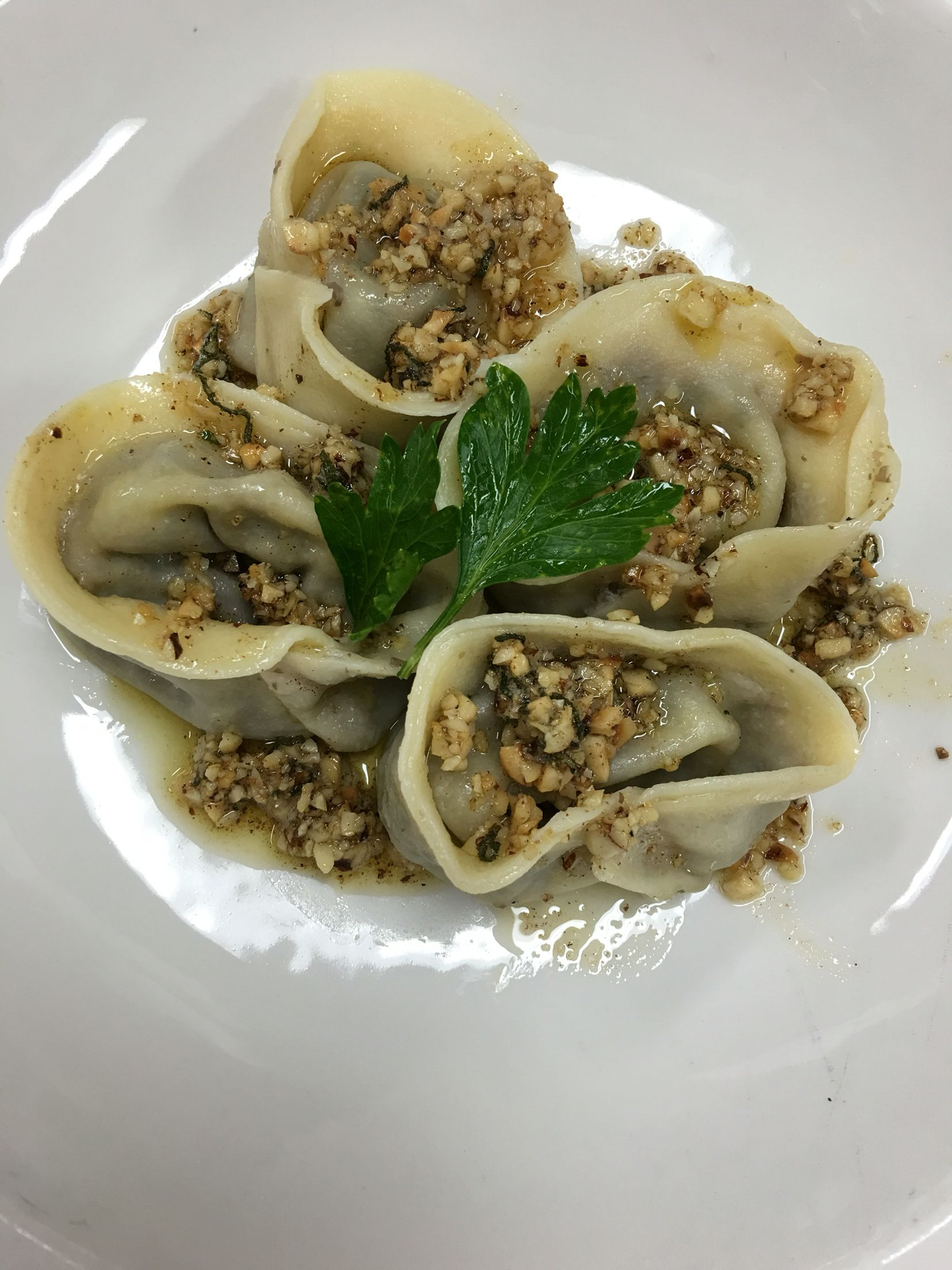 Tortellini filled with mushroom duxelles and blue cheese and drizzled with butter sauce