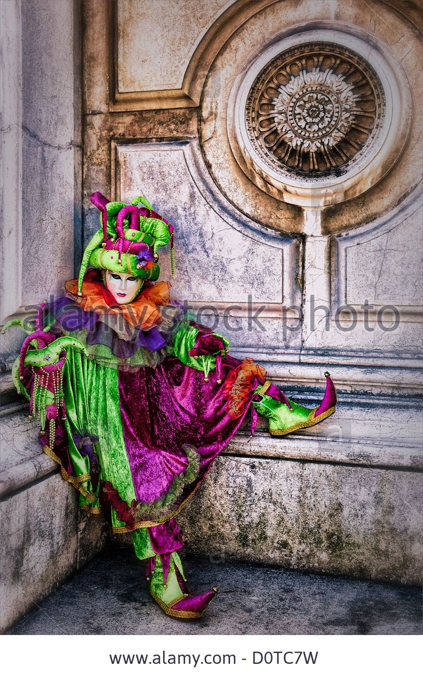 Masked Participant Dressed As A Jester During Carnival In Venice Stock Photo, Picture And Royalty Free Image. Pic. 52167581