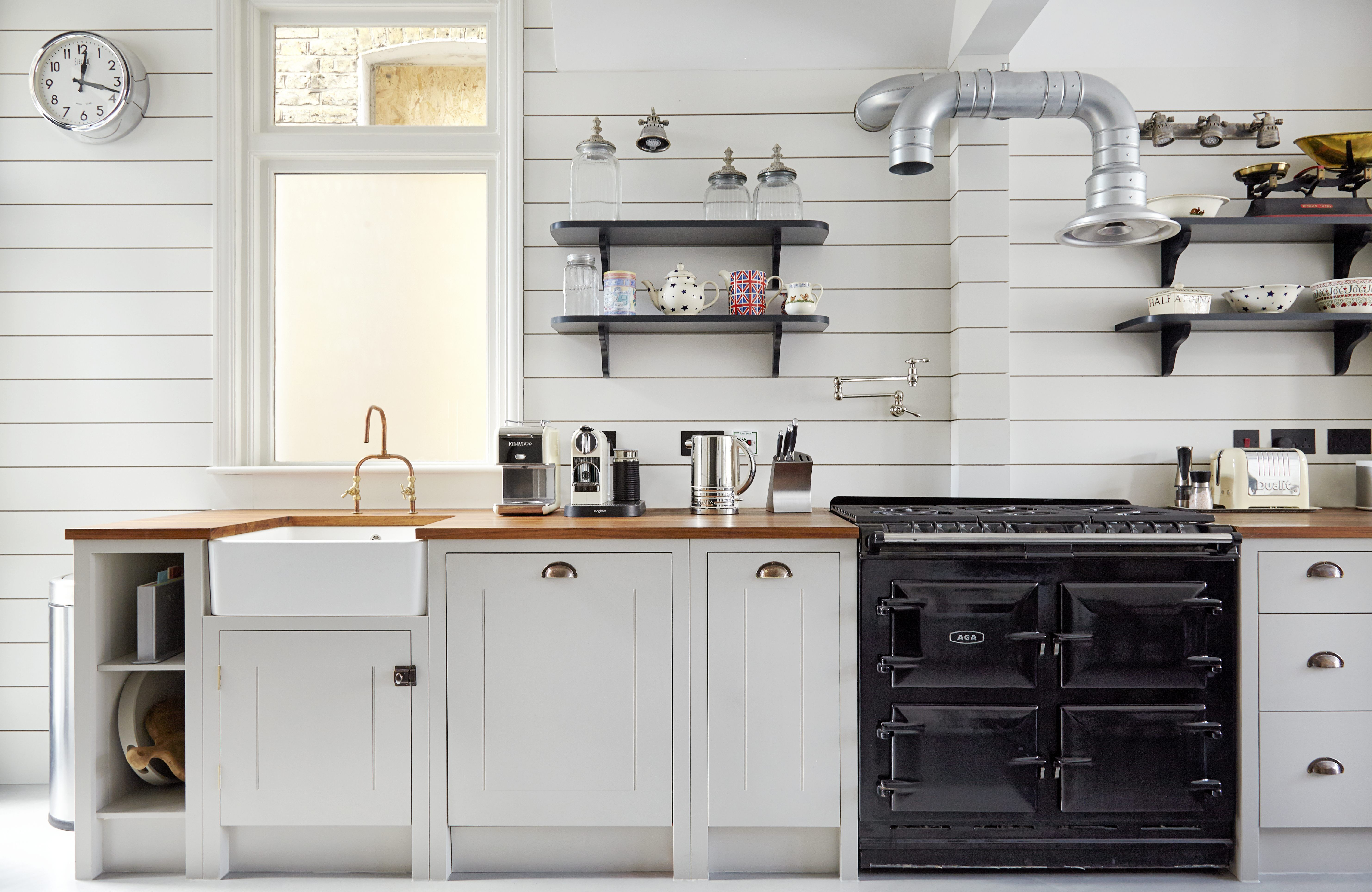 Shiplap wood paneling in a classic English kitchen remodel ...