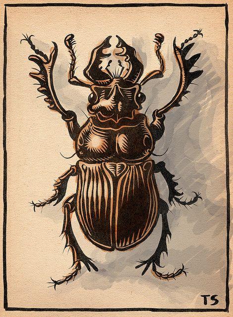 Block printed art Hercules beetle life cycle on wood