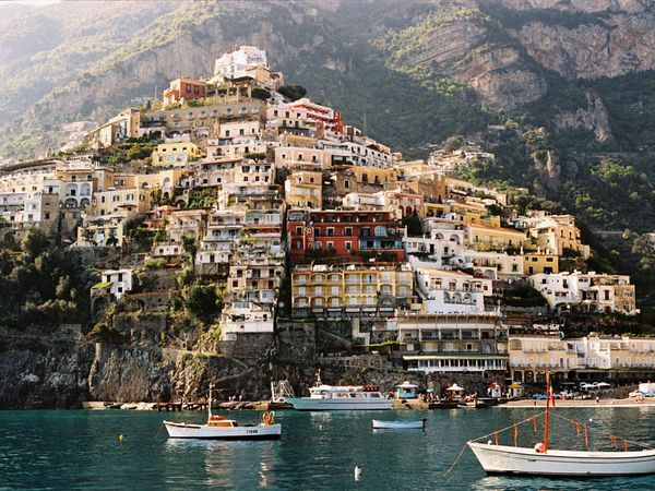 Colorful homes cling to the cliffside in Positano, a town along Italy's Amalfi Coast.    Photograph by Thomas Linkel, laif/Redux